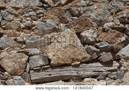 Wall from large stone textured basalt. Good background for wallpaper, web, print, posters design