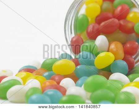 colorful jelly bean pour from glass container