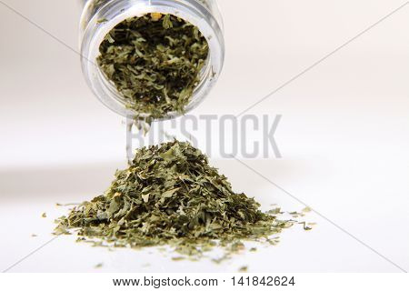 dry parsley with container on the white background