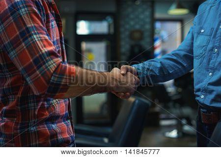 Man handshake close up