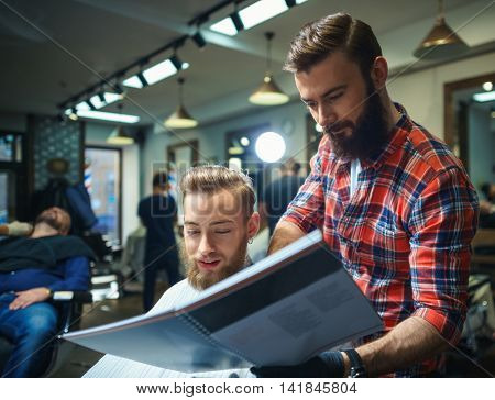 Hairdresser and customer with book