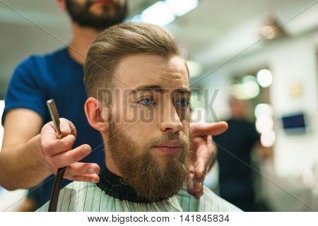 Bearded man in a barber shop