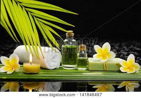 Spa still life with of beautiful orchid and oil, soap and bamboo grove
