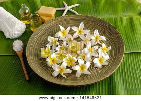 Spa set on banana leaf with in wooden bowl