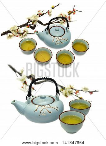 Set with blue ceramic tea pot and cups with green tea and sakura branch, kitchen objects isolated on white