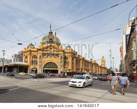 Melbourne - February 23 2016: The main entrance to the railway station Flinders Street Station with a clock and a lot of people around February 23 2016 Melbourne Australia