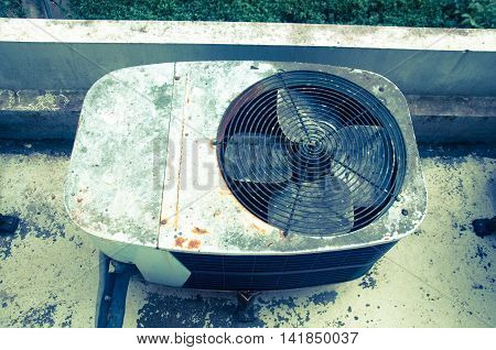 Old rusty air conditioner outdoor in factory
