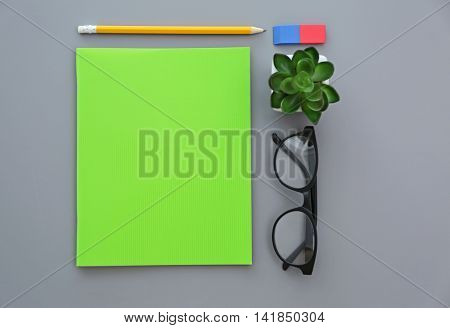 Composition with notebook on grey background