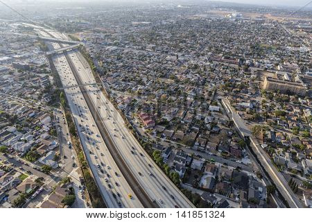 Los Angeles, California, USA - August 6, 2016:  Aerial view of the Century 105 freeway, Inglewood and Los Angeles neighborhoods in smoggy afternoon light.
