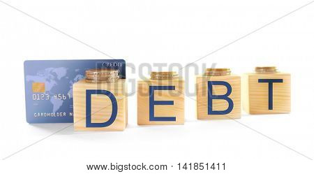 Wooden cubes with word Debt, credit card and coins on white background
