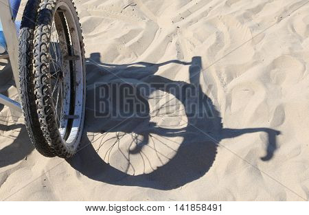 Shadow Of The Wheel Of The Wheelchair On The Sand