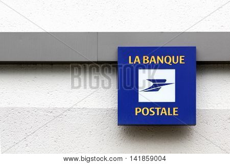 Nantes, France - June 25, 2016: Banque postale logo on a wall. La Banque postale is a French bank created on 1 January 2006 as a subsidiary of La Poste, the national postal service