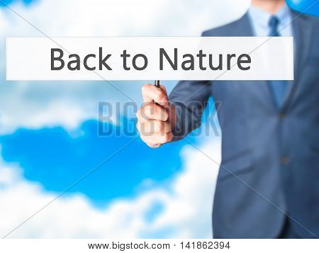 Back To Nature - Business Man Showing Sign