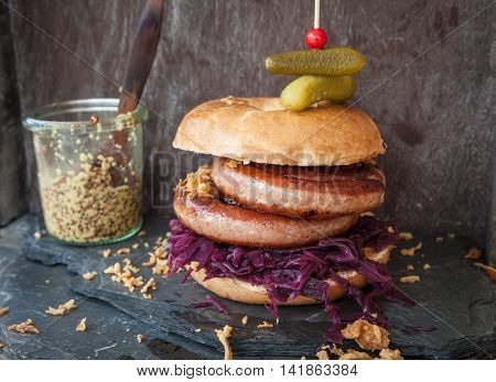 Roasted bratwurst with red cabbage in a bagel