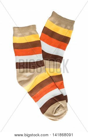 Two striped sock in yellow orange white red-haired brown stripes. isolated