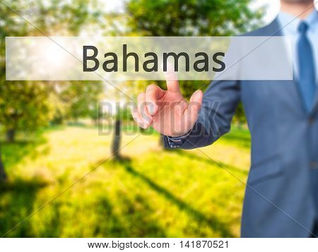 Bahamas - Businessman Hand Pressing Button On Touch Screen Interface.