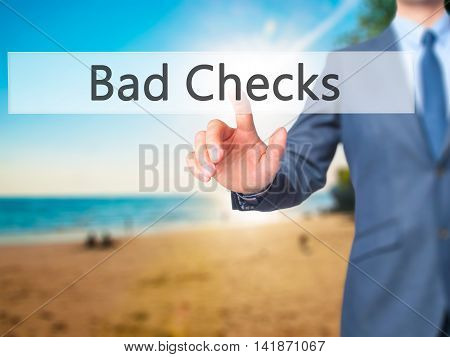 Bad Checks - Businessman Hand Pressing Button On Touch Screen Interface.