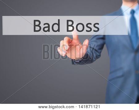 Bad Boss - Businessman Hand Pressing Button On Touch Screen Interface.