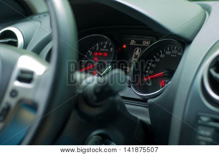 automotive dashboard with gauges and handles day light switch