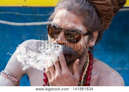A Hindu Sadhu Smoking A Cigarette - India.