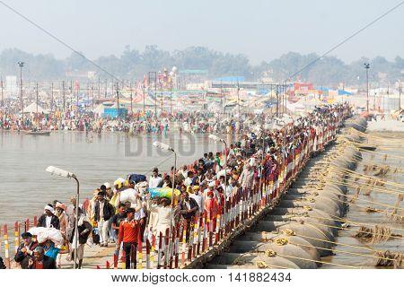 ALLAHABAD, INDIA - FEB 10 - Hindu pilgrims cross bridges into the massive campsite during the festival of Kumbha Mela on February 10th 2013 at Allahabad, India.