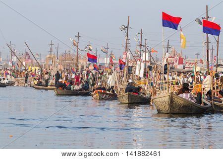 ALLAHABAD INDIA - FEB 14 - Hundreds of boats wait to take Hindu pilgrims across the Ganges river during the festival of Kumbha Mela on February 14th 2013 at Allahabad India.