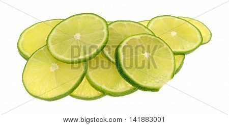 Several cut slices of limes isolated on a white background.