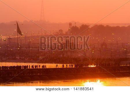Hindu Pilgrims Crossing Pontoon Bridges Into The Kumbha Mela Campsite, India.