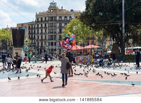 Barcelona Spain - April 3 2016: People walking along the Catalonia Square (Plaza de Cataluna) is a large square in central Barcelona