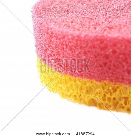 Red and yellow colored bath sponge isolated over the white background, close-up crop fragment as a copyspace backdrop composition