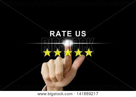 business hand clicking rate us with five stars on screen