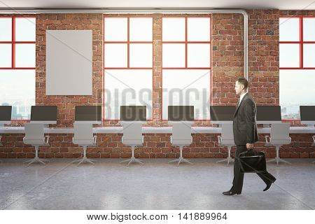 Walking businessman in red brick coworking office with blank poster and city view. Mock up 3D Rendering