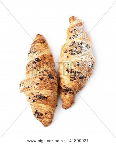 Two chocolate croissants isolated over the white background