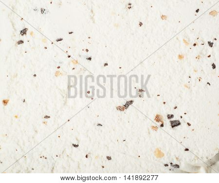 Close-up texture of a chocolate chip vanilla ice cream as a backdrop composition
