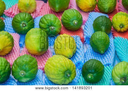The pre-market on Sukkot. Jewish autumn festival in Jerusalem. Funeral citron fruit - Etrog laid out for sale