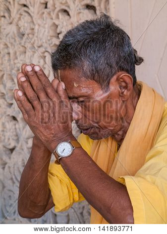 VRINDAVAN, INDIA - OCT 2nd - An old sadhu offering prayers to the Hindu God Krishna on October 2nd 2009