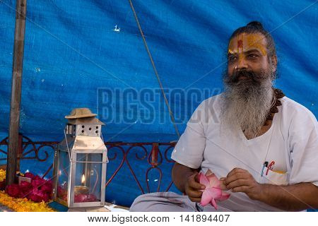 VRINDAVAN, INDIA - AUG 18th 2009 - A Hindu priest prepares for teh evening worship of the holy Yamuna River.