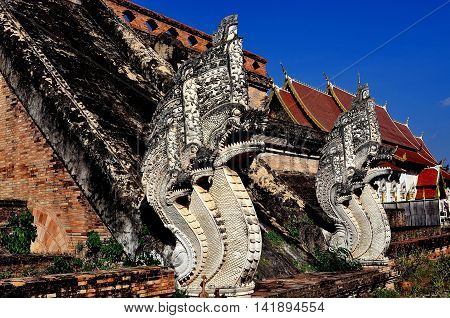 Chiang Mai, Thailand - December 19, 2012: Two of the imposing five-headed Naga staircase figures leading up to the 1401 great Chedi at Wat Chedi Luang
