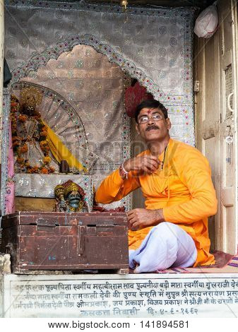 VRINDAVAN, INDIA - OCT 10 - A brahmin priest sitting in the shrine of the Goddess Yamuna in Vrindavan on October 10th 2009