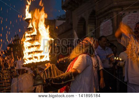 VRINDAVAN, INDIA - AUG 18th - A priest offers a large flaming lamp to the River Goddess Yamuna-devi in Vrindavan, on August 18th 2009