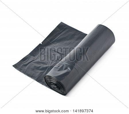 Black plastic polyethylene trash bag roll isolated over the white background