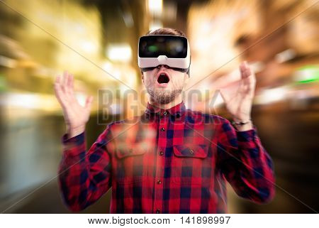 Double Exposure. Man Wearing Virtual Reality Goggles. Night Ligh