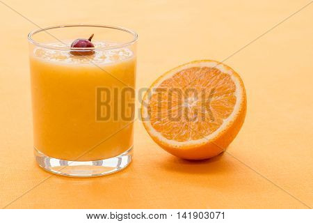 Orange Smoothie With Gooseberry On Orange Background