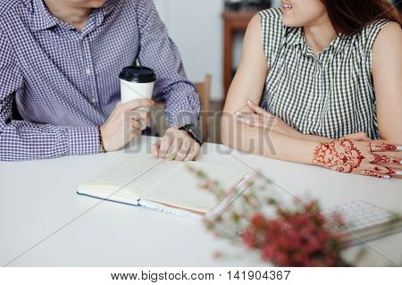 Two creative designers working at white office