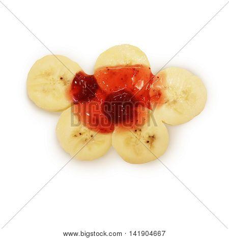 Banana Slit With Strawberry Sauce On White Background