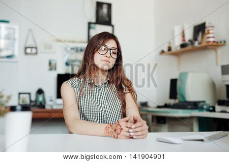 Woman in office having a break for rest