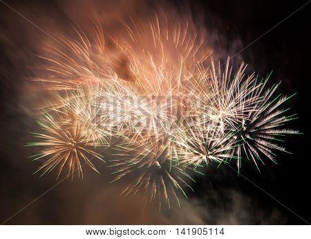 Spectacular fireworks show light up the sky. New year celebration background