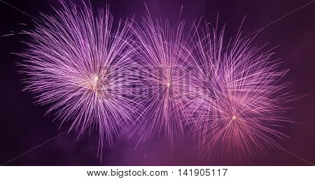 Spectacular fireworks show light up the sky. New year celebration background. Panorama