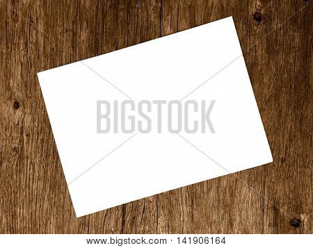 Blank white paper on blurred of wooden background