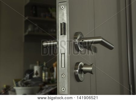 close-up the door face lock and silver handle in the room - can use to display or montage on product